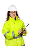 Escritura femenina del trabajador de construcción Foto de archivo