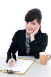 Escritura joven de la mujer de negocios Fotografía de archivo libre de regalías