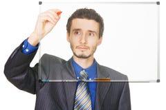 Escritura joven del hombre de negocios con una etiqueta de plástico Fotos de archivo
