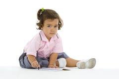 Escritura linda de la muchacha Fotografía de archivo libre de regalías