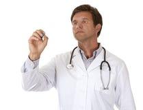 Escritura masculina del doctor Fotografía de archivo libre de regalías