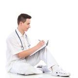 Escritura masculina del estudiante de la medicina Imágenes de archivo libres de regalías