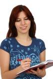 Escritura ocasional del estudiante Fotos de archivo libres de regalías