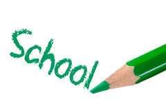Escritura verde del lápiz la escuela de la palabra Fotografía de archivo