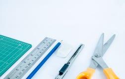 Escritura y herramientas de corte Fotografía de archivo
