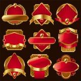 Escrituras de la etiqueta de oro adornadas de lujo. Imágenes de archivo libres de regalías