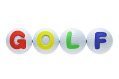 Escrituras de la etiqueta del alfabeto en pelotas de golf Fotos de archivo libres de regalías