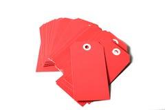 Escrituras de la etiqueta del rojo Imagen de archivo libre de regalías
