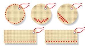 Escrituras de la etiqueta hechas de tela natural con bordado. Imagen de archivo libre de regalías