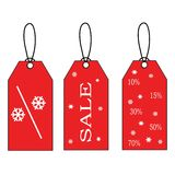 Escrituras de la etiqueta rojas de la venta de la Navidad Imagen de archivo libre de regalías