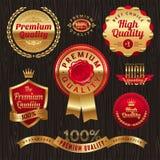 Escrituras de la etiqueta y emblemas de oro de la calidad Fotografía de archivo