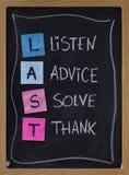Escucha, el consejo, soluciona, agradece Foto de archivo