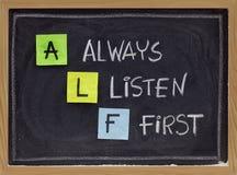 Escuchan siempre primero - las siglas de ALF Imágenes de archivo libres de regalías