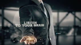 Escuche su cerebro con concepto del hombre de negocios del holograma almacen de metraje de vídeo