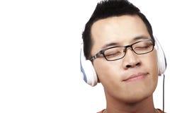 Escuche y disfrute de la música Foto de archivo libre de regalías