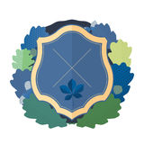 Escudo azul con una guirnalda Imagenes de archivo