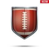 Escudo brillante en la bola del fútbol americano dentro Imagenes de archivo