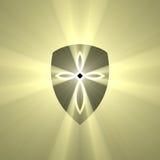 Escudo con la llamarada cruzada de la luz de la marca Imagen de archivo libre de regalías
