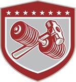 Escudo cruzado de la pesa de gimnasia y de la almádena retro Foto de archivo libre de regalías