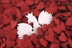 Escudo de armas polaco en corazones rojos Imágenes de archivo libres de regalías