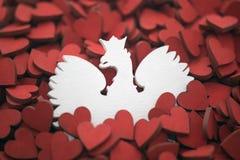 Escudo de armas polaco en corazones rojos Imagenes de archivo