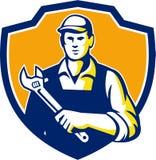 Escudo de Holding Adjustable Wrench del mecánico retro Fotografía de archivo