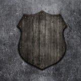 escudo de madera 3D en un fondo del grunge Imagen de archivo libre de regalías