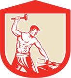 Escudo de Striking Sledgehammer Anvil del herrero retro Imágenes de archivo libres de regalías