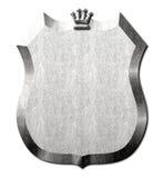 Escudo del metal de la muestra de la corona Imagenes de archivo