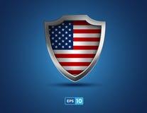 Escudo del metal de los E.E.U.U. en el fondo azul Imagen de archivo libre de regalías