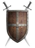 Escudo medieval de madera viejo y dos del cruzado imagen de archivo libre de regalías