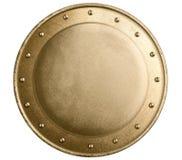 Escudo medieval del metal de bronce redondo aislado Imagen de archivo libre de regalías