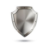 Escudo metálico brillante en blanco Foto de archivo libre de regalías