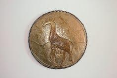Escudo ornamental de la jirafa del metal africano Fotos de archivo