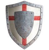 Escudo templar o del cruzado viejo del metal aislado Imágenes de archivo libres de regalías