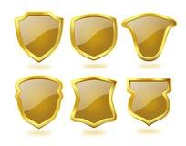 Escudos de oro brillantes con el modelo del control de Brown Fotografía de archivo