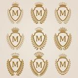Escudos de oro con la guirnalda del laurel Fotos de archivo libres de regalías