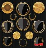 Escudos de oro, etiquetas y laureles, oro y colección negra Fotos de archivo libres de regalías