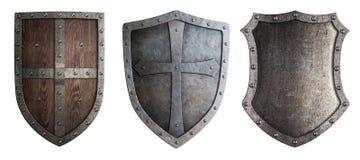 Escudos medievales del metal fijados aislados imagenes de archivo