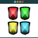 Escudos - rojos, amarillos, azul y verde Foto de archivo libre de regalías