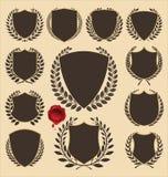 Escudos y colección medievales de la guirnalda del laurel Imagenes de archivo