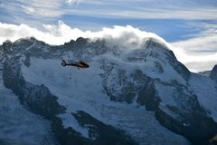 Escue helicopter over the Matterhorn mountain Royalty Free Stock Image