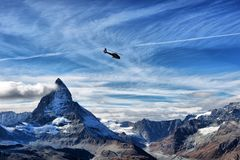 Escue helicopter over the Matterhorn mountain Royalty Free Stock Photography