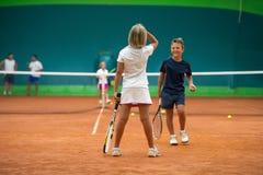Escuela del tenis interior fotografía de archivo
