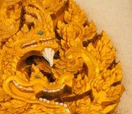 Esculpa la entrada de la ventana de la puerta del ` s de la serpiente del arte Foto de archivo libre de regalías