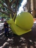 Escultura amarilla gigante del caracol Imagen de archivo libre de regalías