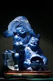 Escultura azul del jade de dios de la riqueza en China Fotos de archivo