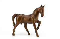 Escultura bonita do cavalo feita da madeira isolada no branco Fotos de Stock Royalty Free