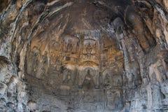 Escultura da Buda na parede da caverna em grutas de Longmen imagem de stock royalty free