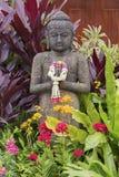 Escultura da Buda no jardim Imagens de Stock